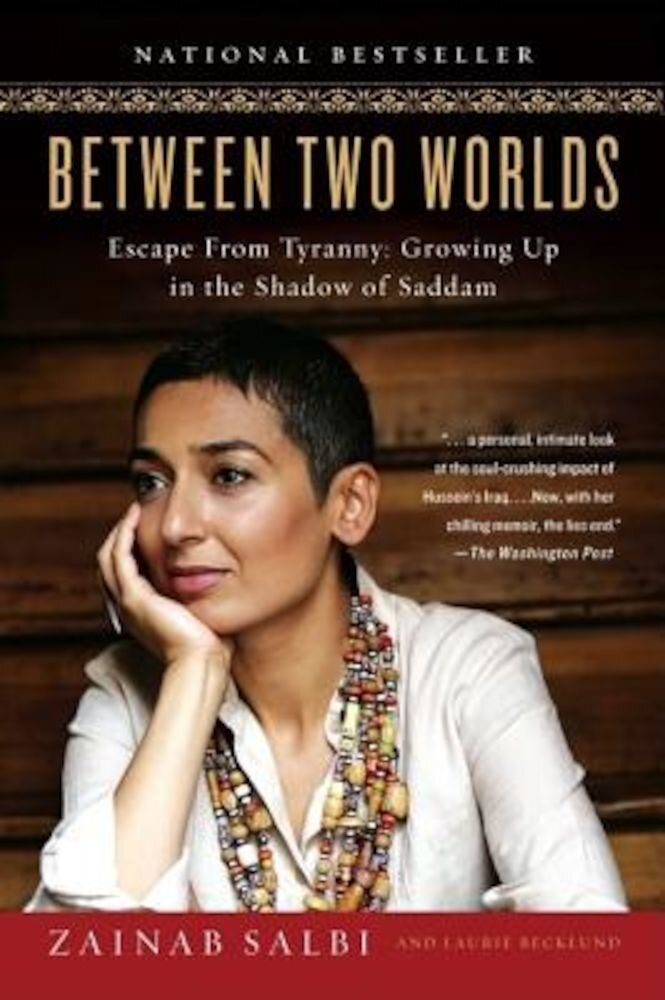 Between Two Worlds: Escape from Tyranny: Growing Up in the Shadow of Saddam, Paperback